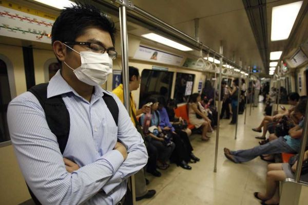 12.12.Masque.pollution.respiratoire.Reuters.930.620