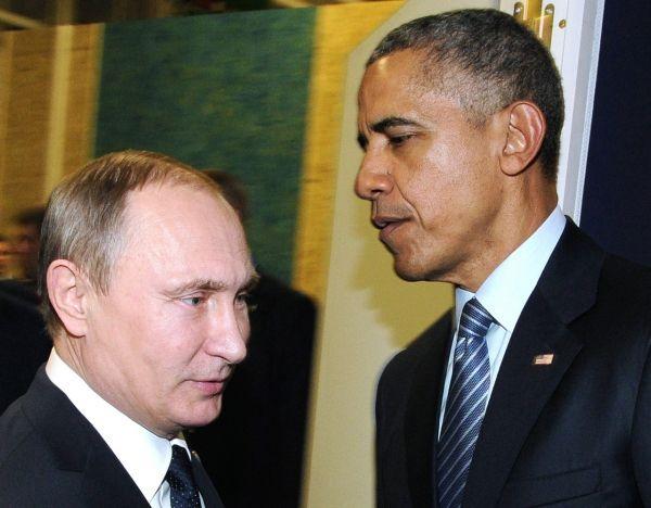 Barack Obama et Vladimir Poutine pendant la COP21