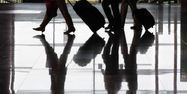 22.03.Voyage transport voyageur valise gare aeroport.FREDERIC J. BROWN  AFP.1280.640
