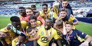 Sochaux et Marcus Thuram (2e à gauche) fêtent leur victoire en Coupe Gambardella. (1280x640) Franck FIFE/AFP