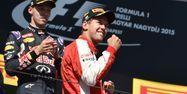 Sebastian Vettel sur le podium du GP de Hongrie (1280x640) Andrej ISAKOVIC/AFP