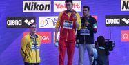 Sun Yang sur le podium du 400 m des Mondiaux 2019 (1280x640) Ed JONES / AFP