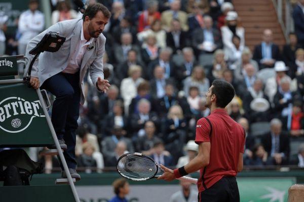 Arbitre avec Djokovic