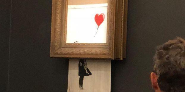 1cadc0795cc Une oeuvre de Banksy s auto-détruit en pleine vente aux enchères à Londres
